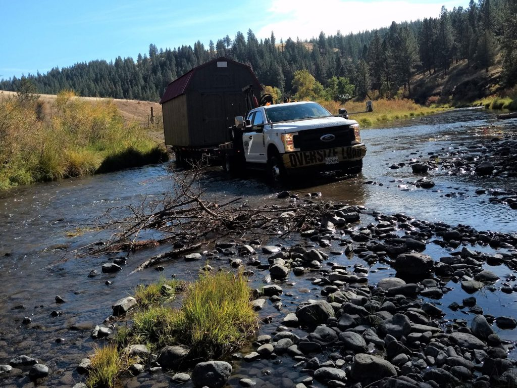 pictured truck delivery across a low portion of a river